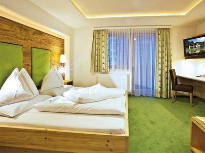 """Photo for Mountain and hiking experience in the room """"Dachstein"""" - Alpenhof, country hotel"""