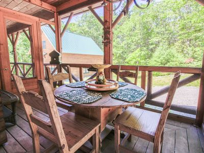 Photo for Beautiful log cabin w/ forest views & wrap-around deck - close to town & beach!