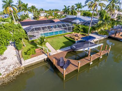 Photo for Luxurious Waterfront Retreat! Amazing heated pool and great outdoor area!