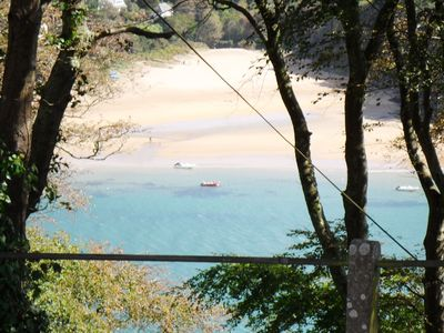 Photo for SUNNY FAMILY HOUSE  above estuary with parking for 2 cars. 10 min walk from town
