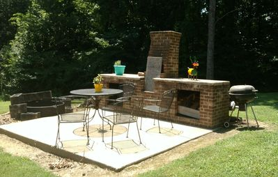 backyard grilling area with fire pit