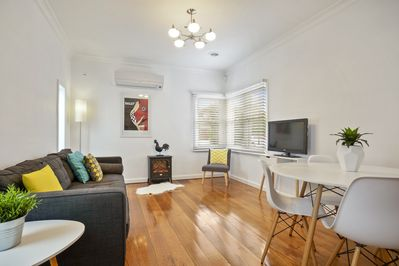 Main living and dining with fireplace & aircon
