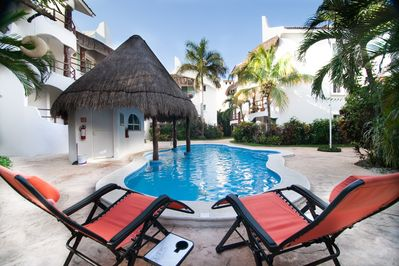 Relax in our zero gravity pool chairs at our quiet swimming pool at Los Lirios