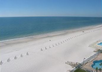 View to your right from 8x22 beachfront balcony with table and lounger