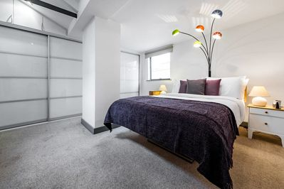 The second double bedroom is spacious and chic.
