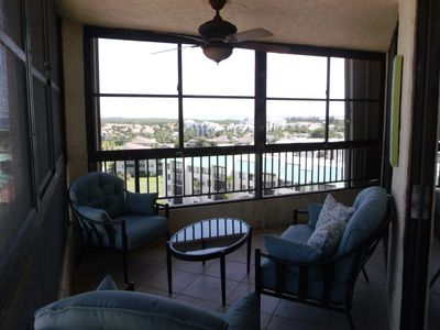 Front balcony with new blue furniture. Better light in next photo