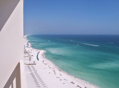 Balcony view to the east, gorgeous white sand and beautiful colors of the ocean