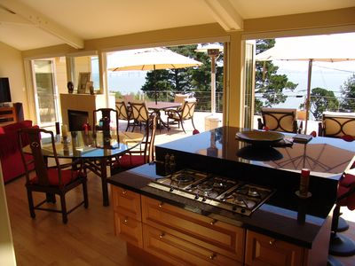 Cooktop center island & six adjustable bar stools and bay view in background