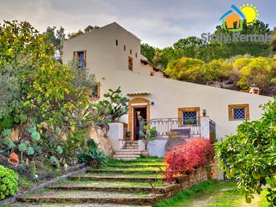 Photo for Cozy villa surrounded by a beautiful garden