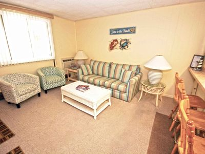 Spacious, traditional 2 bedroom luxury condo with free WiFi and picnic area located uptown near mini golf and movie theaters and less than a block from the beach!