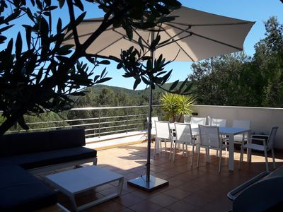 Salon terrace with dinner table and lounge. Stunning views