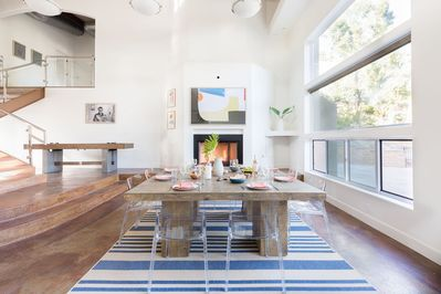 Dining area. With a fireplace and a shuffleboard table in the back.
