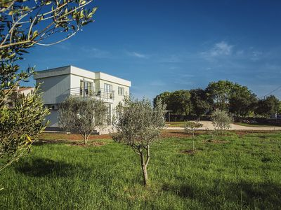 Photo for New and modern holiday home for sole use with 3 bedrooms, 2 bathrooms, Wi-Fi, air conditioning, terrace, barbecue near the beaches and towns of Istria