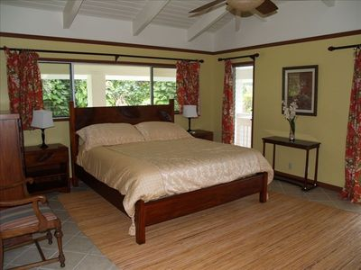 Master bedroom with waterfall view and a sliding door to the front lanai