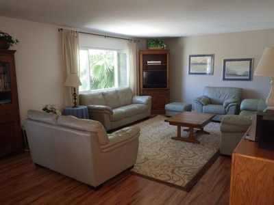 Our living room with new flooring, leather furniture and interactive TV and DVD