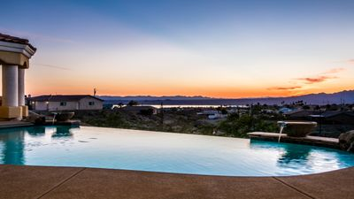 Photo for Custom Built Home With Panoramic Lake Views, Heated Infinity Pool And Jacuzzi