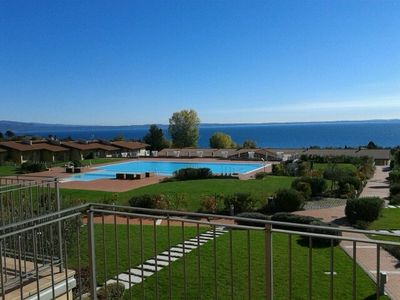Photo for Montecolo Resort three bedroom apartment with beautiful lake view, swimming pool