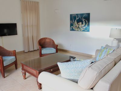 Photo for Large 1 bedroom courtyard, 100 steps to Grace Bay beach~open July 4th!