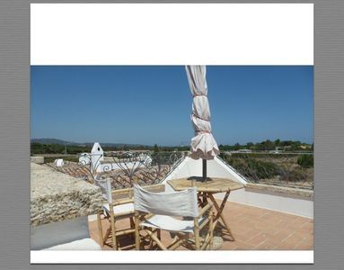 Photo for Holiday house with garden 400 meters from the beach of Porto Ainu