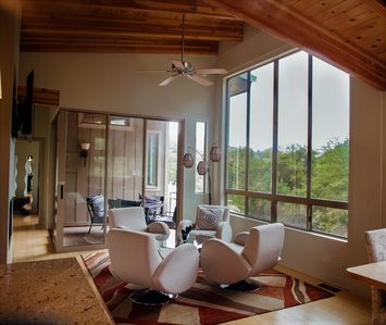 beautiful front room with VIEWS VIEWS VIEWS ...looking towards bedroom and patio
