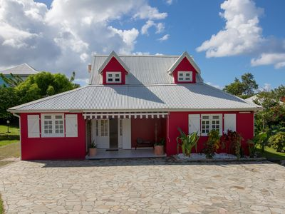 Photo for Creole villa in the heart of a garden with swimming pool and beach 15 minutes walk