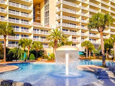 Photo for Beautiful waterfront condo w/ shared pool, hot tub, gym - beach access!