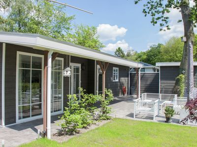 Photo for Luxurious detached chalet with a pond view, situated in a forested park