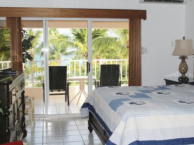 Photo for AWESOME Beachfront Condo with AMAZING Views, Cowpet Bay Beach
