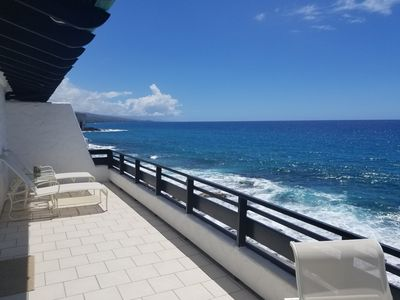 Photo for Sunset views!! Hear the ocean!! Ocean Front condo with large wrap around lanai!!