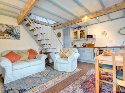 Photo for The Stables is a semi detached character cottage adjoining a pretty traditional farmhouse in the tra