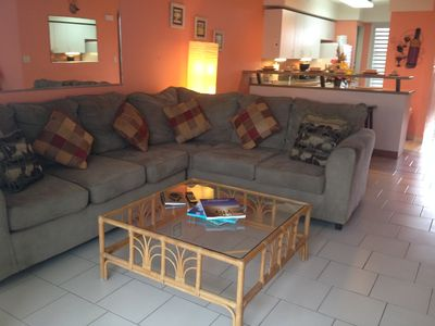 Nice comfy sectional to relax on while you enjoy the pool  and ocean views and breezes