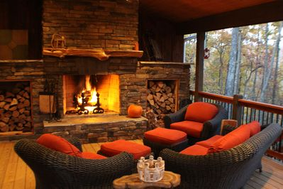 Outdoor Fireplace and small section of the covered porch.