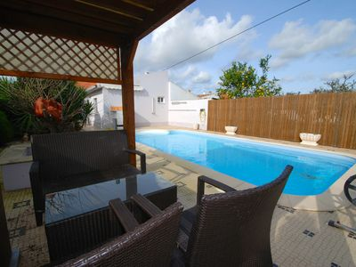 Photo for Laranjeira - House with garden and private heated pool, parking and WiFi