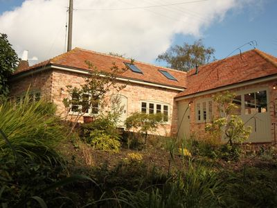 Photo for The Old Stables - Private Garden, Huge Communal Grounds and Wild Swimming Pond