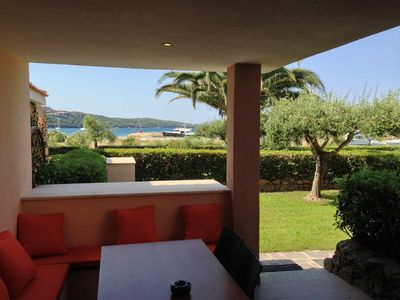 Photo for Apartment, surrounded by greenery, with sea view and swimming pool.