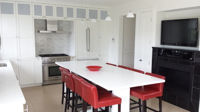 Dine-in open kitchen featuring deluxe appliances