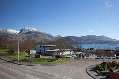 Amazing backdrop of Ben Nevis & Loch Linnhe, taken from first floor of our building, with the train station & Caledonian Canal also in view.