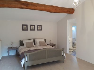 The room has big oak beams and views over the garden.