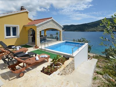 Photo for Holiday house seafront with pool