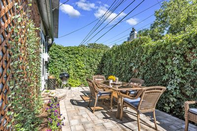 Sunny, private fenced patio with seating for 8.