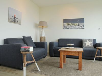 Photo for Holiday apartment with a view of the dunes, sea, and lighthouse