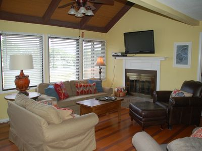 sun filled family room, with 42' flat screen television