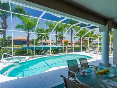 Photo for White Sands, minutes to Cape Harbor, electric heated pool/spa gulf access canal, office, bikes and 3