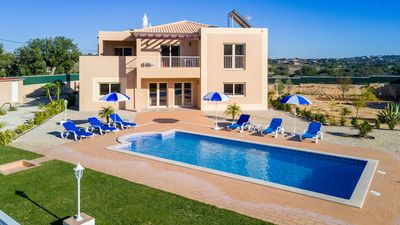 Photo for UP TO 60% OFF! Modern villa with heatable pool and garden on walled plot,AC,WiFi