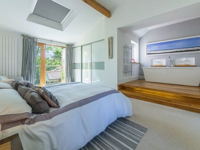 Photo for A contemporary four-bedroom cottage situated a short walk to Holme Beach.