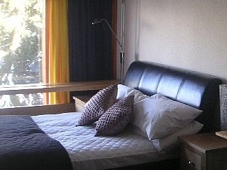 Double leather bed upstairs in bedroom
