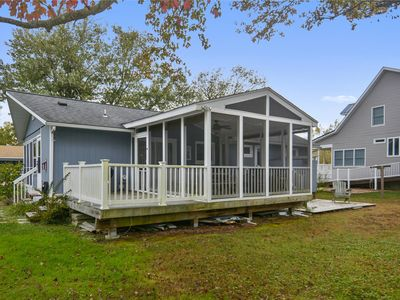 Photo for FREE DAILY ACTIVITIES!! Charming and cheerful beach cottage has two awesome screen porches to relax and enjoy!