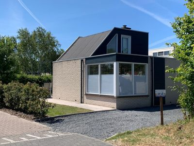 Photo for The attractively furnished bungalow with lots of light is situated on the child-friendly park De Klepperstee, close to the beach and the dunes in Ouddorp. The bungalow was completely renovated in 2019.