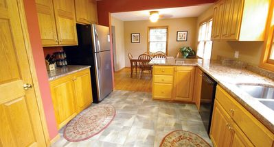 Upscale Kitchen, Granite Counters, Wood Floors, Ceramic Tile, Stainless Steel