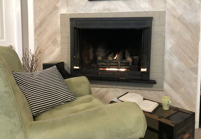 Cozy up to the fireplace and read a book.